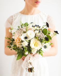 At her Greek-Canadian October wedding, Trish carried a bouquet of viburnum berries, scabiosa, snowberries, garden roses, and herbs—believed to drive away evil spirits and symbolize prosperity.