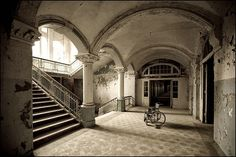 Lonely wheelchair in an abandoned, ex-soviet hospital in Germany
