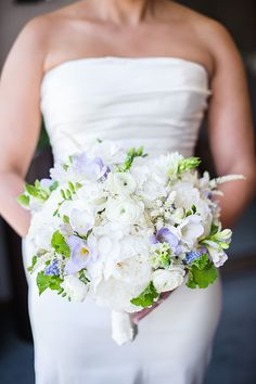 Bouquet of Peonies, Lisianthus, Ranunculus, Astilbe, and Muscari | Brides.com