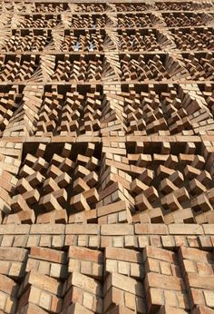 Beautiful Brickwork as Solar Screen is part of architecture - Looking like a Jenga stack on steroids, this beautiful brick facade shields the South Asian Human Rights Documentation Centre in India, doing double duty as a solar screen and noise buffer Brick Art, Brick Tiles, Brick Facade, Brick Paving, Brick Design, Facade Design, Exterior Design, Wall Design, Architecture Design