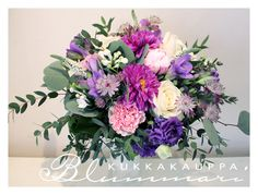 Natural wedding bouquet with purple colors