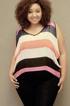 LOOOOVE her hair! I hope that mine grows out like this. Wonderfully defined curls, great shape, and I'd try this color.