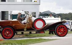 Motoring fanatic: Chris Evans has upset those in Overton, Hampshire, after he arrived to host CarFest in this vintage car from Chitty Chitty Bang Bang