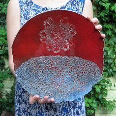 a lovely red ceramic plate with blue lace pattern fo wall deco and good moods :)