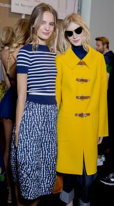 Love the outfit on the left: Striped navy blue shirt and midi skirt. Michael Kors #FW Spring 2015 backstage. Photo by Kevin Tachman. #Vogue