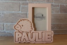www.woodpeckerwoodshop.etsy.com Personalize this hedgehog or porcupine themed picture frame for the favorite kid or family pet in your life!  Search on Etsy for WoodpeckerWoodShop for 100+ personalized children's frames - choose your name, colors and theme!