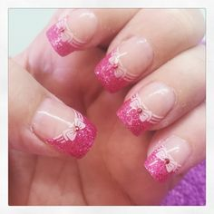 Pink sparkle nails with bows