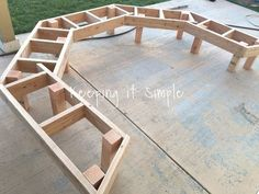 Upgrade your fire pit with this fire pit bench! You can make go all around the fire pit or just have it have three sections. Either way it's awesome! diy fire pit DIY Fire Pit Bench with Step by Step Insructions Fire Pit Bench, Fire Pit Seating, Fire Pit Area, Diy Fire Pit, Fire Pit Backyard, Backyard Patio, Backyard Landscaping, Backyard Seating, Backyard Ideas