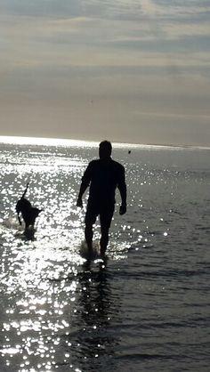 #man#dog#sun#beach