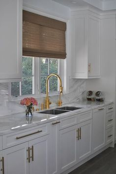 A window dressed in a brown bamboo roman shade is flanked by white cabinets and . - A window dressed in a brown bamboo roman shade is flanked by white cabinets and positioned above a - White Farmhouse Kitchens, White Kitchen Sink, Farmhouse Kitchen Cabinets, Kitchen Countertops, Marble Countertops, Kitchen Backsplash, Granite Backsplash, Kitchen Pulls, Farmhouse Sinks