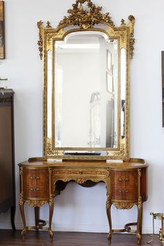 A stunning #antique #French #mirror with #handcrafted gilded plaster details -- at Artiques, in Hamilton, ON. http://artiquesgallery.ca/