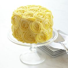 Perfect to share with mom on her big day - a cake with fluffy yellow buttercream roses!