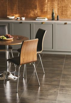Metallic Steel porcelain tiles look great on a kitchen floor. Especially coupled with a Copper Leaf glass splashback. originalstyle.com