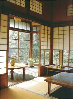 Japanese style house. Screens on barn door rails & pulleys for heights.