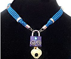 $ strands of braided ocean blue leather on the BDSM Collar. Lock is not included, but used to show that this collar can indeed be locked on. bdsm collar, strand bdsm, lock