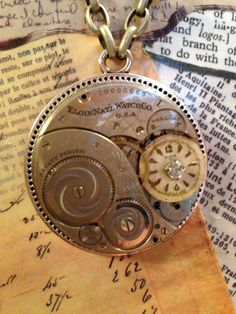 "Steampunk Pocket Watch Movement Necklace on a 30"" Antique Silver chain.  A Steampunk design by LoveEuniceDesigns"