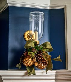 Classic hurricane sconces dressed for the holidays in client's dining room... See more in @cottagesgardens holiday issue! It's all about the details -- zoom in! ✨Those are real artichokes spray-painted gold...✨ Sconces from @vaughandesigns. Wall color #HagueBlue @farrowandball. #hilderbrandinteriors #antiquehouse #christmasdecorations #christmasinconnecticut #classicinteriordesign #goldspraypaint