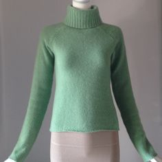 "Omnia cashmere sweater Very soft. Faint sigh of wear at sleeve hem when view very close show in last picture. great condition. Light green. Underarm across 15"" shoulder to hem 19.5"" very soft. Omnia Sweaters Cowl & Turtlenecks"