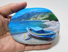 Hand painted stone beautiful Landscape ! A fishing boat on a Greek beach of Ikaria! A great handmade painted stone made by me! Is painted on a