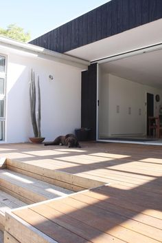 deck at house height with few steps down, rest of deck has high step-off
