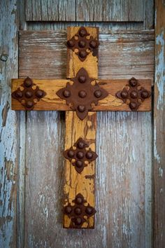 A reclaimed pine wood cross with hand hammered metal medallions make this a truly wonderful piece. - Handmade cross - Reclaimed pine wood - Hand hammered metal medallion accents - Measures about 11 x
