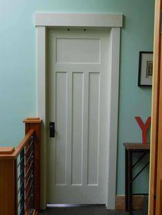 http://hammerlikeagirl.files.wordpress.com/2012/02/bedroomdoor1_a.jpg >> simple trim possibility for bedroom door.