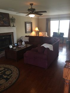 BEFORE PHOTOS- Living Room, dark walls, no lighting except for ceiling fan, fireplace outdated.