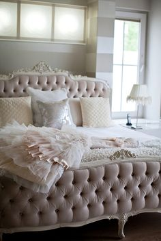 What a beautiful boudoir!.. Love the romantic bed and pale pink tones.    by adene photography