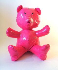 PINKY Bear is designed and handmade by craftsmen in our workshop in north of France.  He is unique.  Design and original, Pinky is decorated with three silver metal studs on the front. It is an ideal Teddy Bear for your interior or to offer .  For collector , fan of design and original object, futuristic decor.  Used materials : - It is made of pink waxed fabric with silver sequins ; 100% Polyester. - It is padded wadding 100% polyester (washable, rot-proof , anti-mite). - The eyes and nose…
