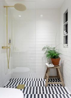 Love the tile choices for the floor and walls in this gorgeous black and white bathroom