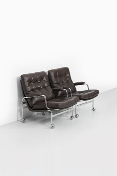 Bruno Mathsson Karin easy chairs in dark brown leather at Studio Schalling