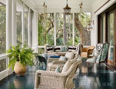 Quintessential Southern design with a touch of whimsy—we adore this stunning South Carolina porch by Michelle Smith at Studio MRS! Indoor Window Boxes, Outdoor Spaces, Outdoor Living, Sunroom Decorating, Interior Decorating, Sunroom Ideas, Porch Ideas, Patio Ideas, Decorating Ideas