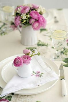 Creamers as individual setting floral arrangements. Perfect for a garden tea party.