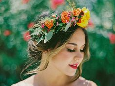 A mix of large and small blooms with a bit of greenery, like these eucalyptus leaves, orange ranunculus, pink hypericum berries and purple wax flowers make a bold statement for wedding flower crowns. Flower Crown Wedding, Bridal Crown, Bridal Hair, Wedding Flowers, Flower Crowns, Hair Wedding, Wedding Crowns, Wedding Veils, Bridal Headpieces