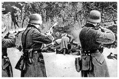 German soldiers executing civilians after the invasion of Poland (1939).