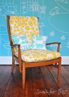 A restored vintage Parker Knoll chair with yellow and white upholstery for our baby daughter's nursery by Simply The Nest