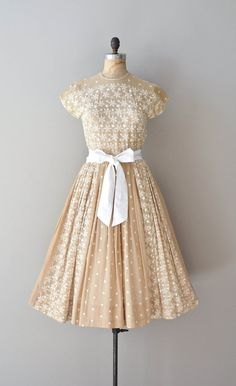 A light tan 1950s dress with white dainty embroidery.  #1950s #dress