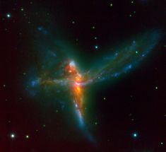 The Tinker Bell Triplet is composed of two massive spiral galaxies and a third irregular galaxy.