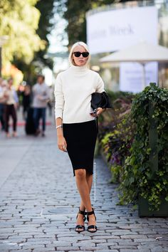 the look for early fall is definitely black skirt, white top with turtleneck, and ankle strapped sandals