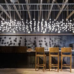 Two hundred and seventy six teacups are suspended from the ceiling of this coffee shop in Bucharest by Romanian studio Lama Architectura