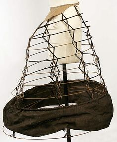 Cage crinoline with unusual design of narrow X tapes instead of wide vertical tapes. Met Museum dates to but that's an awful lot of back thrust. Victorian Era, Victorian Fashion, Vintage Fashion, Victorian Costume, Vintage Underwear, Vintage Lingerie, Historical Costume, Historical Clothing, 1850s Fashion