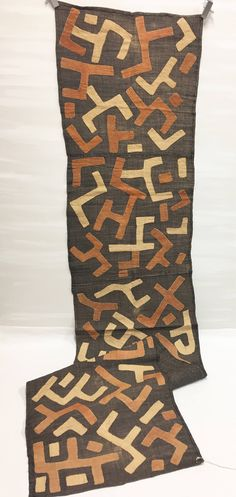 A personal favorite from my Etsy shop https://www.etsy.com/listing/538035844/kuba-cloth-raffia-textile-brown-with