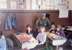 Egyptian officer from the United Nations PROFOR posing with children in a school in Seravejo Bosnia 1993[960x666]