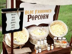 A great option to a candy bar... a popcorn bar complete with toppings and spices!