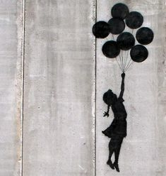 Banksy - Balloon Girl this is my favorite piece of street art by Banksy. It's so simple, I just love it!!