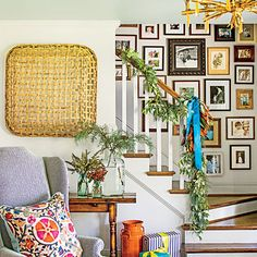 The Stairway | A mix of seeded eucalyptus, magnolia, and spruce is wired together to hang loosely on the banister.