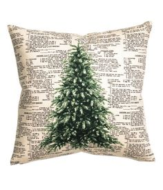 Natural white/fir. Cushion cover in unbleached cotton twill with a printed pattern at front and a solid-color back section. Concealed zip.