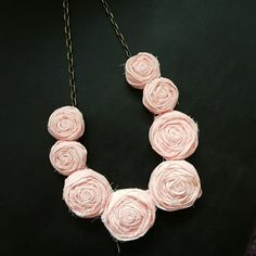 Rosebud cloth necklace Beautiful off pink material woven into Rosebuds. This lays flat on your neck, just below your collar bone. It clasps on the back with a chain. You can make it as long or short as you'd like. Comes in a few colors. :-)  All new. 25% off bundles of 3 . The Pleated Poppy Jewelry Necklaces