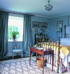 """A Beni Ourain in the bedroom ~Jane Ormsby Gore ~ home on Welsh border -  a Lalique ceiling light hangs over a brass bed that's been in the family """"forever"""". Photography: Tim Beddow"""