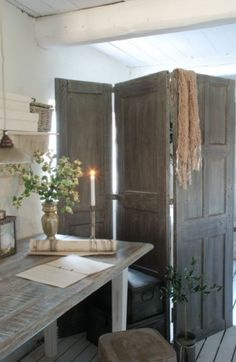 Here is an old garage door being used as a wooden screen to get dressed behind
